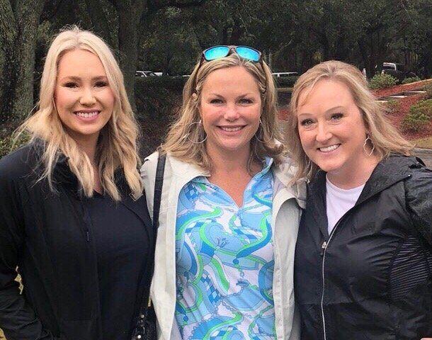 Three smiling blonde women
