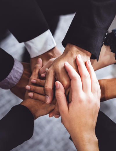 business partners' hands in teamwork gesture